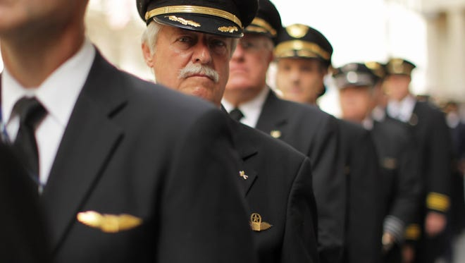 More than 700 hundred Continental and United pilots, joined by additional pilots from other Air Line Pilots Association (ALPA) carriers, demonstrate in front of Wall Street on September 27, 2011 in New York City. The pilots want to draw attention to the lack of progress on negotiations of the pilots' joint collective bargaining agreement ahead of the one-year anniversary of the corporate merger close date of United and Continental airlines.