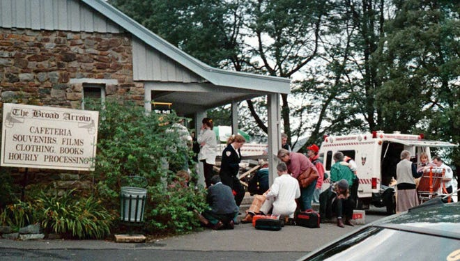 Emergency personnel treat shooting victims near near the historical Port Arthur site on Tasmania on April 28, 1996. A gunman with a high-powered rifle killed 35 people in the worst mass killing in Australian history. The massacre led to the passage of sweeping gun control legislation.
