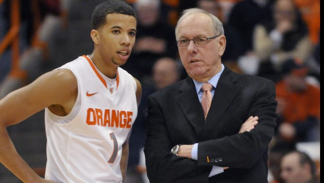 Syracuse coach Jim Boeheim talks with Michael Carter-Williams during the first half of the Orange's victory over Detroit on Monday. The victory was the 900th of Boeheim's career.