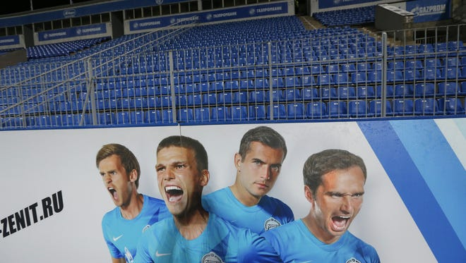 A Zenit supporting poster seen at Petrovsky Stadium without spectators during the Russian National championship soccer match, between CSKA and Zenit St. Petersburg in St. Petersburg, Russia, on Nov. 26. The Russian football federation handed Zenit St. Petersburg a 3-0 technical defeat for a game suspended after Dynamo Moscow's goalkeeper was injured by fireworks thrown from the Zenit supporters section. The federation's disciplinary committee says Zenit has also been fined 1.13 million rubles ($35,300) and ordered to play its next two Russian league matches without spectators.