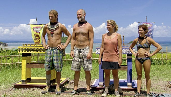 Malcolm Freberg, left, Michael Skupin, Lisa Whelchel and Denise Stapley line up before the final Immunity Challenge during the season finale of 'Survivor: Philippines' on Sunday.