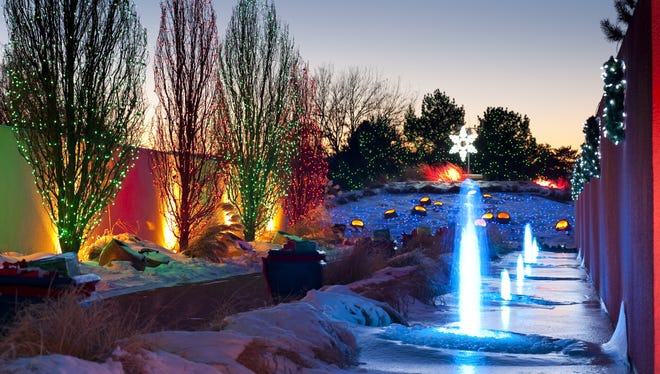 Blossoms of Light at Denver Botanic Gardens lights up the Colorado night with ornately decorated scenes and foliage.
