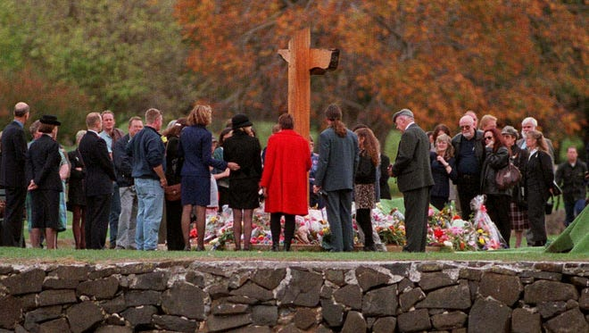 In this 1997 photo, families and friends gather at an Australian service in memory of the 35 people killed a year before in Port Arthur.