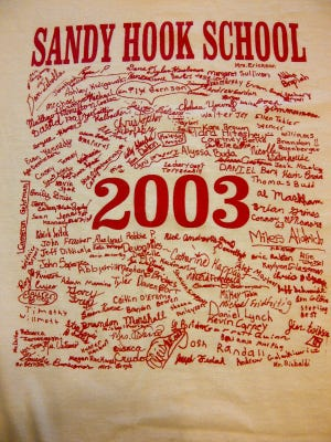 The signatures of Adam Lanza (upper left above the 2) and his fifth-grade classmates appear on a Sandy Hook Elementary T-shirt made by the school and given to each student.