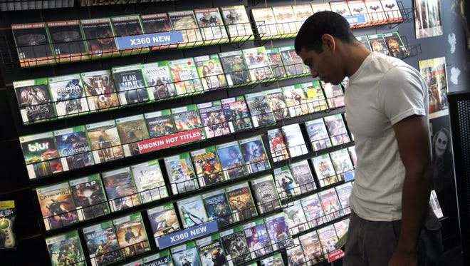 Xabriel Carpio shops for a video game to purchase at Play n Trade video game store in Miami.