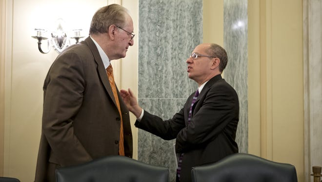 Sen. Jay Rockefeller, D-W.Va., left, and Federal Trade Commission Chairman Jon Leibowitz, right, confer at the start of a meeting on the new Children's Online Privacy Protection Act.