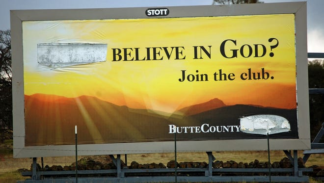 """Less than a week after an atheist group posted this billboard in Chico, Calif., the sign, which originally read """"Don't believe in God? Join the club,""""? was defaced by vandals who removed the word """"Don't."""""""
