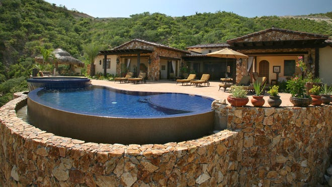 Infinity pools like this one are a popular addition to high-end homes.