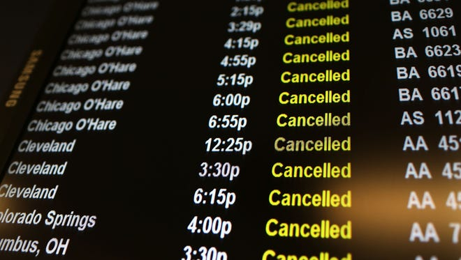 Flights canceled due to a storm are viewed on a schedule board at LaGuardia Airport on Nov. 7, 2012, in New York City.