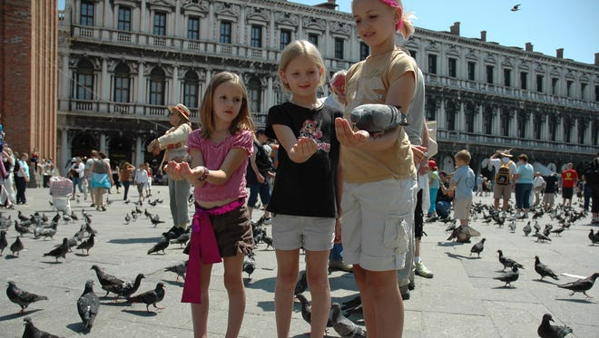 Feeding pigeons in St. Mark's Square in Venice is now illegal. The new law ends a long tradition of pigeons landing on tourists who are willing to exchange some avian bacteria for a photograph or two.