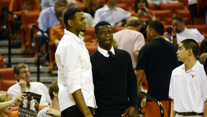 Texas guard Myck Kabongo, right, watches from the sidelines in a game against Fresno State this season. Kabongo has been sitting out this season and could now miss the rest of the season.