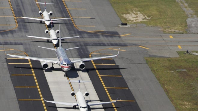 Planes taxi to a runway at John F. Kennedy International Airport in New York.