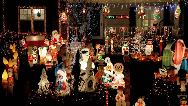 A yard in Cary, N.C., is festooned with Christmas lights and decorations. Holiday celebrations in the South are more laid-back than other parts of the country, according to a survey.