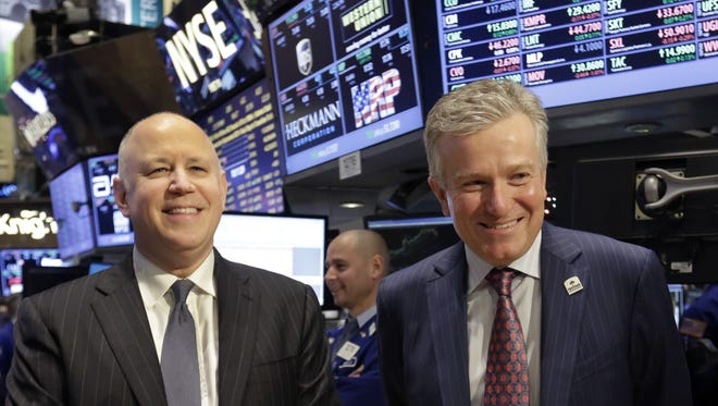 ICE Chairman and CEO Jeffrey Sprecher, left, and NYSE CEO Duncan Niederauer prepare for an interview on the floor of the New York Stock Exchange Dec. 20, 2012.