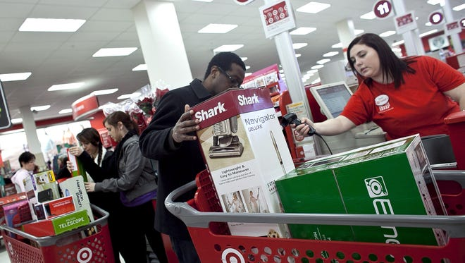 Shoppers check out during sales at Target in Braintree, Mass.