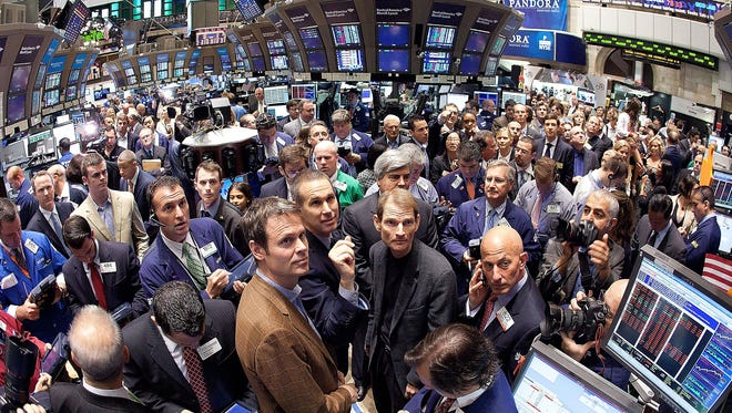 Pandora music founder and Chief Strategy Officer Tim Westergren, center left, and Joe Kennedy, company CEO and president, watch as the company's stock opens for trading at the New York Stock Exchange on June 15, 2011.