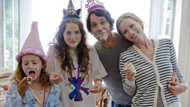 The uneven 'This is 40,' starring Iris Apatow, left, Maude Apatow, Paul Rudd, left, and Leslie Mann, gets points for its brutal honesty, but falls short of comedy front.