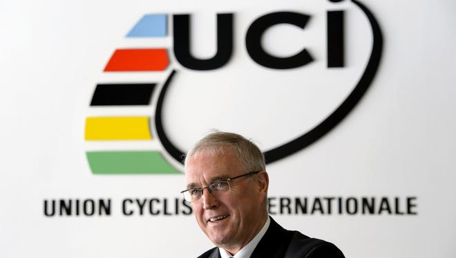International Cycling Union (UCI) president Pat McQuaid poses for a photo on December 13, 2012, at the World cycling governing body's headquarters in Aigle, Switzerland.