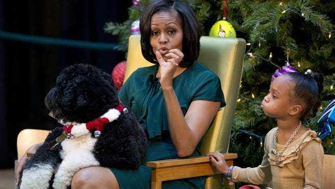 First lady Michelle Obama, with first dog Bo, answers questions from children earlier this month next to Jordyn Akuoko, 5, at Children's National Medical Center in Washington.
