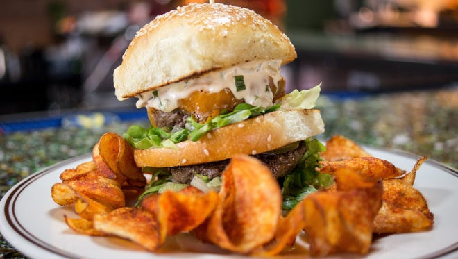 The focus at Alla Spina is on small plates. However, there's nothing small about the double-decker burger dubbed 'The Burgamo.' It features two four-ounce patties made from Piedmontese beef and comes topped with cheddar, chopped lettuce and spicy housemade pickles. It's served with thick-cut potato chips (choose BBQ or salt and vinegar).