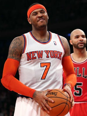 Knicks forward Carmelo Anthony shows his frustration during Friday's 110-106 loss to the Bulls.