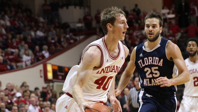 Hoosiers forward Cody Zeller (40), driving the baseline against the Owls, scored 24 points in Indiana's 88-52 win.