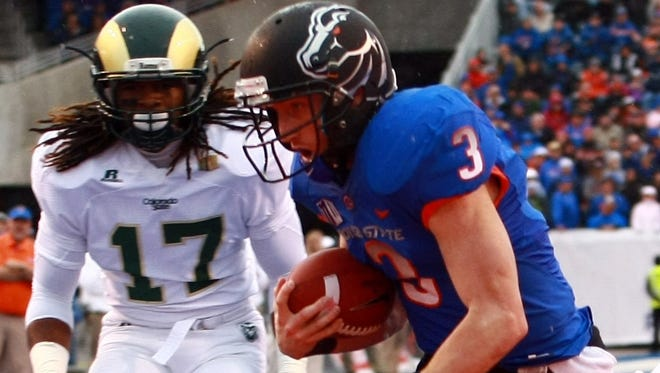 Boise State wide receiver Chris Potter (3) scores a touch down during the first half of the Broncos game against Colorado State on Nov. 17. Boise State's consistent record of top 20 national rankings makes it an attractive team for leagues vying to be part of college football's new playoff picture.