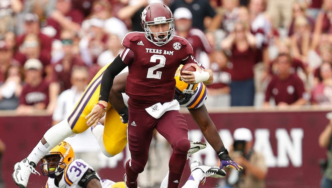 Texas A&M quarterback Johnny Manziel will be a challenge for the Oklahoma defense in the Cotton Bowl.