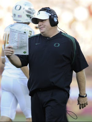 Ducks coach Chip Kelly says Oregon has cooperated fully with an NCAA investigation over payments to recruiting services.