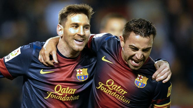 Lionel Messi, right, and Xavi Hernandez each scored to help Barcelona stay unbeaten.