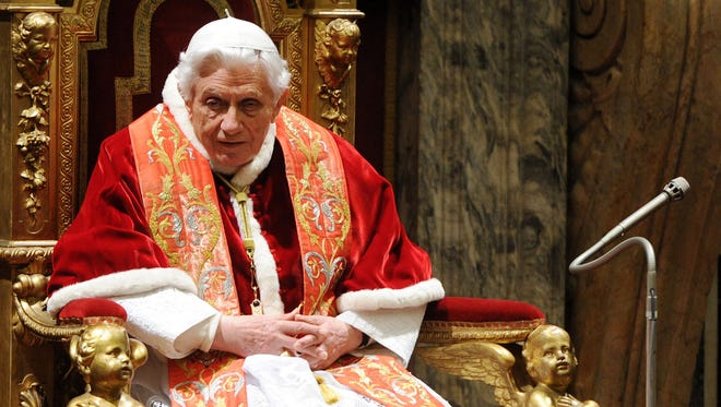 Pope Benedict XVI receives the Roman Curia for the annual Christmas greetings at the Clementina Hall on Friday in Vatican City.