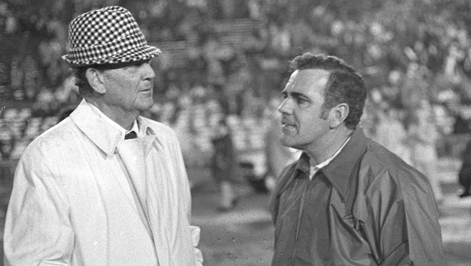 "Alabama coach Paul ""Bear"" Bryant talks with Notre Dame coach Ara Parseghian prior to the 1973 Sugar Bowl in New Orleans, La."