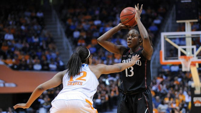 Stanford Cardinal forward Chiney Ogwumike (13) looks to pass the ball against Tennessee Lady Volunteers forward/center Bashaara Graves (12) during the second half at Thompson-Boling Arena. Stanford won 73-60.