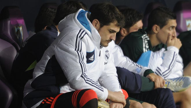 Real Madrid goalkeeper Iker Casillas looks on from the bench during Saturday's loss to Malaga.