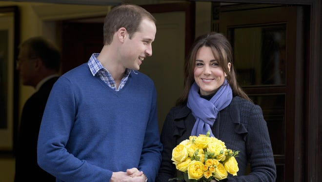 Prince William stand next to his wife, Kate, as she leaves the King Edward VII hospital in London on Dec. 6.