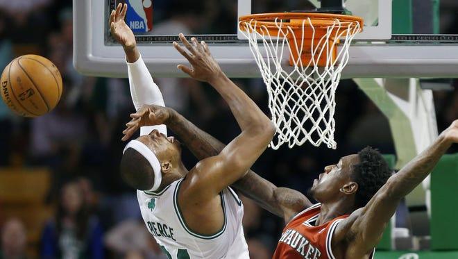 Bucks forward Larry Sanders blocks Celtics forward Paul Pierce during Friday's 99-94 overtime win.