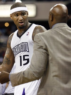DeMarcus Cousins talks to coach Keith Smart during the Kings' loss on Nov. 30.