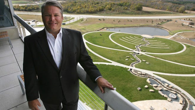 Aviva CEO Chris Littlefield shows off the headquarters in October 2010. He doesn't know yet if the Apollo deal will alter Aviva's current employee numbers in the Des Moines area.