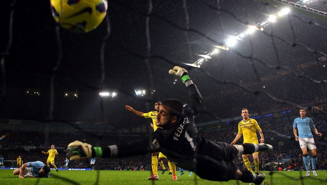 Gareth Barry put a header past Adam Federici to give Manchester City a 1-0 win.