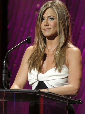 Jennifer Aniston speaks onstage during the American Cinematheque 26th Annual Award Presentation to Ben Stiller 2012 at the Beverly Hilton Hotel.