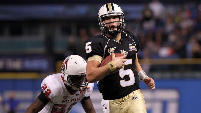 Central Florida quarterback Blake Bortles (5) runs with the ball as Ball State cornerback Quintin Cooper (22) chases during the first half of Friday's Beef O'Brady's Bowl.