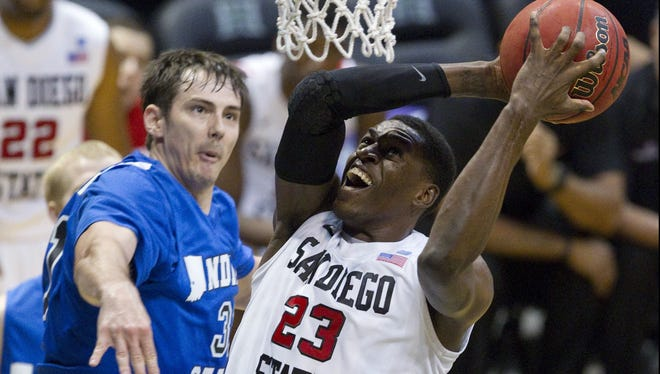 San Diego State forward Deshawn Stephens (23) powers up a shot while being over Indiana State forward RJ Mahurin, left, in the second half of the Diamond Head Classic.