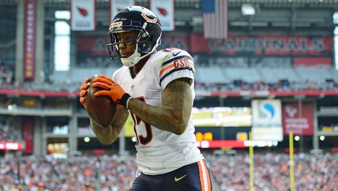 Chicago Bears wide receiver Brandon Marshall (15) catches a touchdown pass in the second quarter against the Arizona Cardinals at University of Phoenix Stadium.