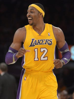 Los Angeles Lakers forward Dwight Howard (12) reacts during the game against the Charlotte Bobcats at the Staples Center.
