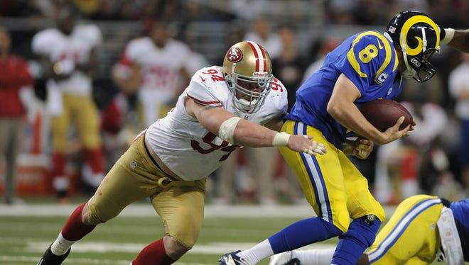 San Francisco 49ers defensive end Justin Smith (94) sacks St. Louis Rams quarterback Sam Bradford (8) during the second half at the Edward Jones Dome.