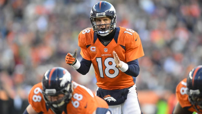 Denver Broncos quarterback Peyton Manning (18) checks off during the second quarter of the game against the Cleveland Browns at Sports Authority Field.