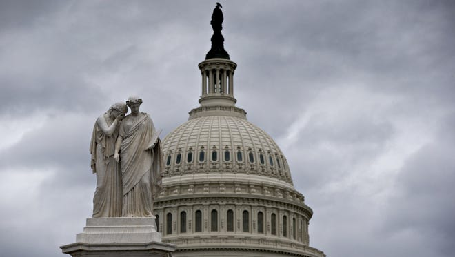 """Gray skies cover the U.S. Capitol in Washington on Friday as Congress closed down without a compromise on the """"fiscal cliff"""" threatening the U.S. economy."""