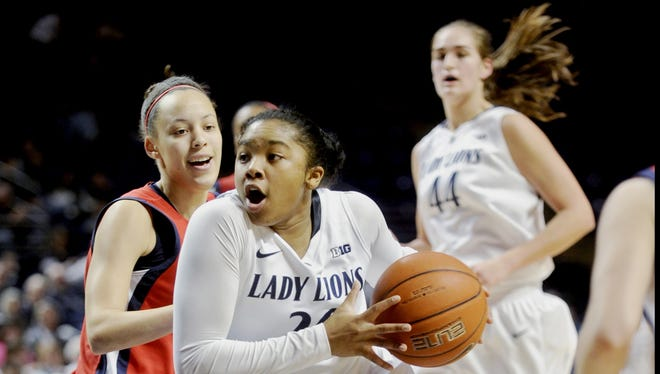 Penn State's Alex Bentley flies through the lane past NJIT's Kim Tullis during Suday's game in State College, Pa.