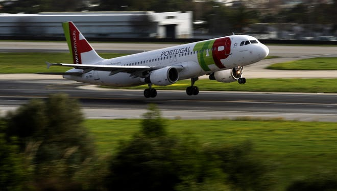 A TAP airplane takes off from Lisbon's Portela international airport on Dec. 20, 2012.