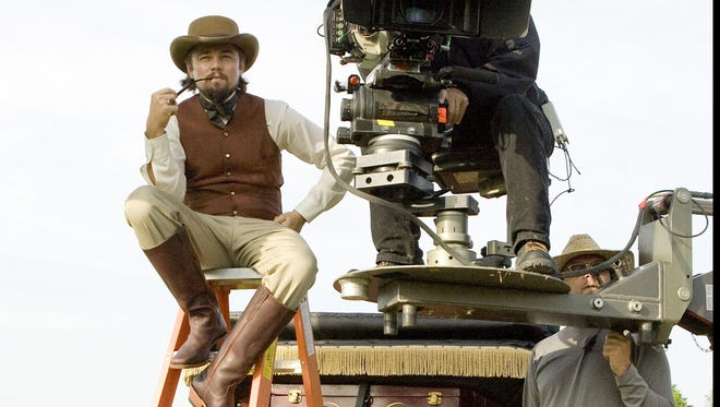 Leonardo DiCaprio in character on the set of Django Unchained.'